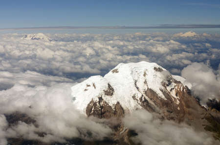Cayambe Volcano in the Ecuadorian Andes viewed from the air with Antisana and Cotopaxi in the distance