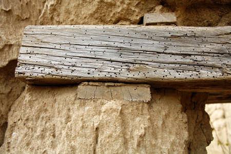 lintel: Lintel with woodworm in an abandoned house