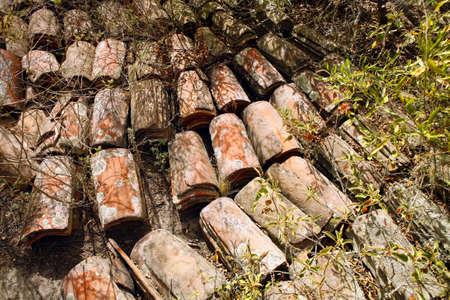 terra: Collapsed terra cotta tile roof