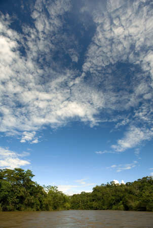 Blue sky over the Arajuno river in the Ecuadorian Amazon photo