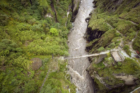 Dangerous bridge crossing the  upper Rio Pastaza, Ecuador, on the eastern slopes of the Andes