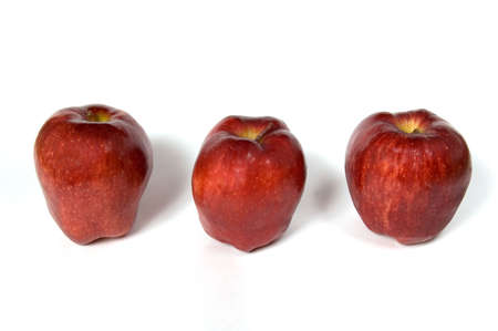 Three red apples in row photo