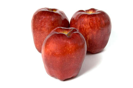 Three red apples isolated on white photo