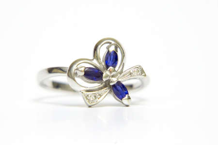 White gold ring with sapphires, isolated on white photo
