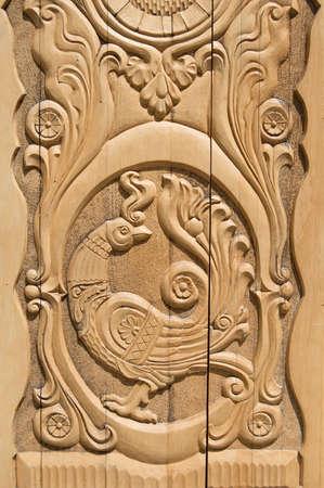 woodcarving: Wooden Firebird, russian door pattern Stock Photo