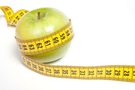 Green Apple with measuring tape, isolated on white. Diet concept Stock Photo - 5570709