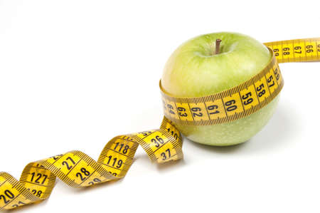 Green Apple with measuring tape, isolated on white. Diet concept photo