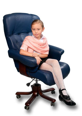 Portrait of attractive little girl sitting on office chair, isolated on white. photo