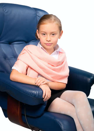 little girl sitting: Portrait of attractive little girl sitting on office chair, isolated on white.