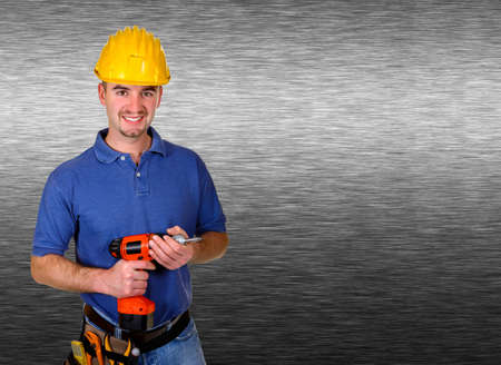 isolated standing young worker with space for text brushed metal background photo