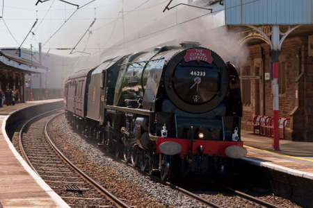 The Citadel Express.  Preserved steam locomotive 46233 Duchess of Sutherland heads the Citadel Express northbound through Penrith station in Cumbria, on the west coast mainline. Editorial