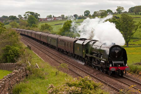 The Hadrian.  Preserved steam locomotive 46233 Duchess of Sutherland heads the Hadrian through Lazonby, on the Settle to Carlisle railway. Editoriali
