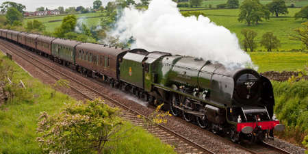 The Hadrian. Preserved steam locomotive 46233 Duchess of Sutherland heads the Hadrian through Lazonby, on the Settle to Carlisle railway.