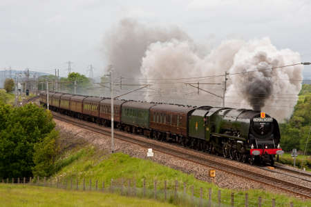 The Royal Scot.  Preserved steam locomotive 46233 Duchess of Sutherland heads the Royal Scot southbound through Hackthorpe, Cumbria, on the west coast mainline.