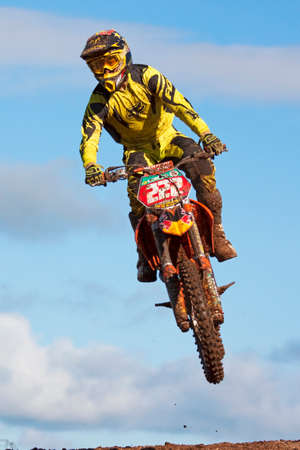 motorcross: Motocross Rider.  An unidentified motocross rider takes part in the East Cumbria Motocross, Championship Round 1 at Low Gelt Motocross track in Cumbria, England.