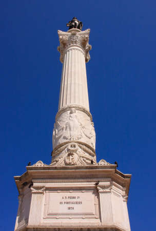 dom: Dom Pedro IV Monument.  The monument to king Dom Pedro IV is situated in Rossio Square in Lisbon, Portugal.
