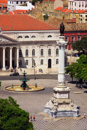 dom: Rossio Square, Lisbon.  Rossio Square (or Pedro IV Square) is situated in the heart of Lisbon, Portugal, and in the foreground is a monument to king Dom Pedro IV.
