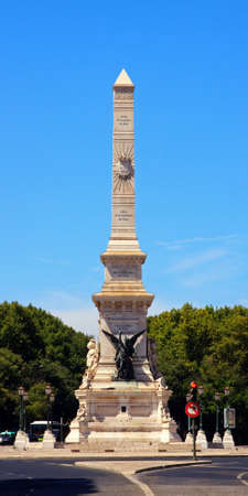 obelisk stone: Monument to the Restorers.  The monument is located in Restauradores Square in Lisbon, Portugal. The monument marks the restoration of Portuguese independence in 1640 after 60 years of Spanish rule.