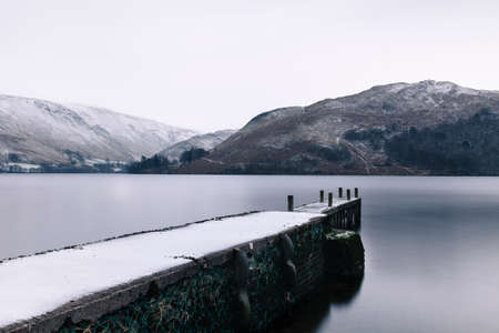 Ullswater Winter Scene.  The winter scene includes a landing stage on the banks of Ullswater, Cumbria in the English Lake District.