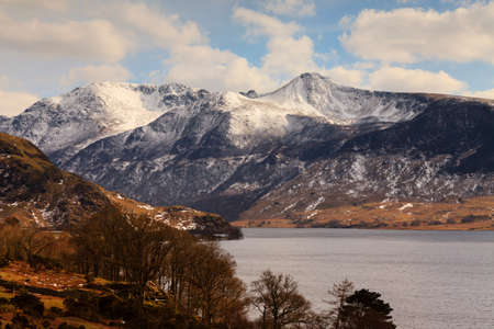 Winter Lake Scene.  A view across Crummock Water towards the snow capped lakeland fells in the English Lake District national park.