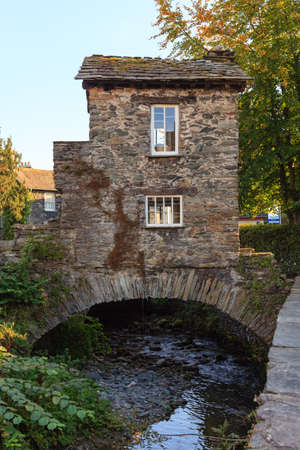 cumbria: Bridge House .  Bridge House a 17th century old stone cottage perched over Stock Beck in Ambleside, Cumbria, in the English Lake District.