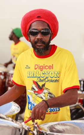 The Halcyon Steel Orchestra perform on the St Johns quayside in Antigua.  The steel drum originates from Trinidad and Tobago in the West Indies. Sajtókép