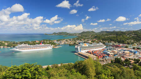 Cruise ships Carnival Valor and P&O Ventura docked in Castries. The sheltered harbour offers a preferred destination for cruise ships.