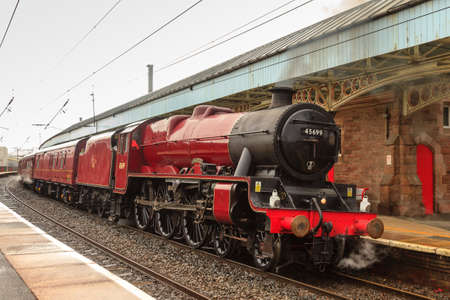 Winter Cumbrian Mountain Express.  Preserved steam locomotive Galatea is pictured in Penrith, England.  Galatea was withdrawn from service in 1964 before returning to service in 2013.