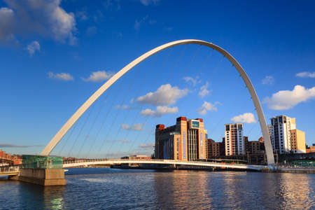Gateshead Millennium Bridge with the Baltic Centre for Contemporary Art. The bridge spans the River Tyne in north east England. Editorial