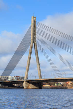 The view across the River Daugava to Vansu Bridge (Vansu Tilts).  The bridge is a cable stayed bridge in Riga the capital city of Latvia.
