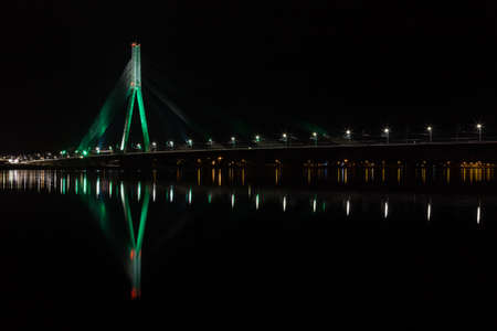 Vansu Bridge.  A night time view across the River Daugava to Vansu Bridge (Vansu Tilts).  The bridge is a cable stayed bridge in Riga the capital city of Latvia.