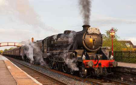 Preserved Black Five steam locomotive number 48151 at the head of The Highlands and Islands Explorer in Appleby, England, on the Settle to Carlisle railway. Editorial