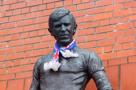 A statue of John Greig outside the Main Stand at Ibrox Stadium in Scotland celebrating his contribution to Glasgow Rangers Football Club.