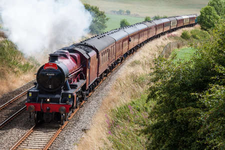 Preserved steam locomotive Galatea heads the Waverley south of Langwathby, England, on the Settle to Carlisle railway. Editorial