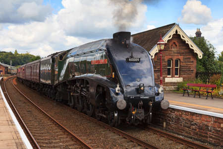 Preserved steam locomotive, Union of South Africa, heads the Cumbrian Mountain Express through Lazonby station, on the Settle to Carlisle railway.