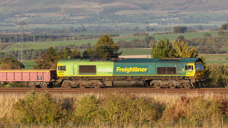 A Freightliner train pictured on the west coast mainline in Clifton, Cumbria.  Freightliner is a multinational rail freight and logistics company.