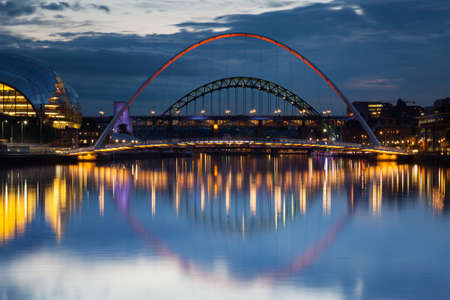 Gateshead Evening.  The image shows Gateshead Millenium Bridge in the foreground with the Sage and the Tyne Bridge in the background.