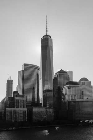 A black and white image of the Lower Manhattan skyline in New York City.  The One World Trade Centre dominates the skyline. Editorial