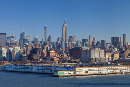 The Midtown Manhattan skyline in New York City.  The Empire State Building dominates the skyline and behind is the Chrysler Building.