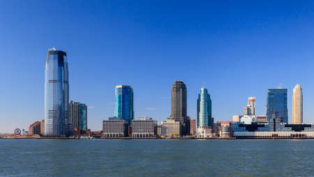 The waterfront of Jersey City as viewed from the Hudson River.  The Goldman Sachs tower can be seen dominating the skyline at 238 metres high. Redakční