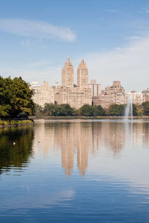 The view across the Jackie Onassis Reservoir in Central Park, New York City on a still autumn morning. Stock Photo