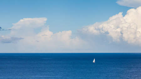 Isolated Yacht.  An isolated yacht sails off the coast of La Palma the Spanish Canary island. Stok Fotoğraf