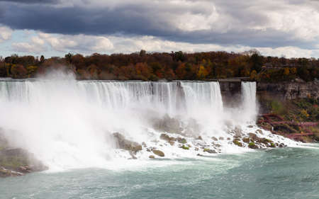 A close up view of the American Falls, a part of the Niagara Falls.  The falls straddle the border between America and Canada.