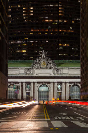 Grand Central Station. The exterior of Grand Central Station, New York City. Passing traffic is captured by the colourful light trails.