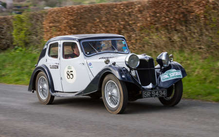 A 1937 Riley 15/6 climbs Southwaite Hill in Cumbria, England. The car is taking part in the 11th Flying Scotsman Rally, a free public-event.