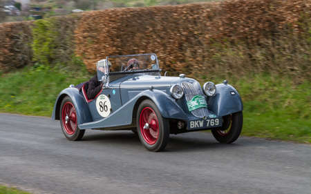 A 1937 Riley Sprite climbs Southwaite Hill in Cumbria, England. The car is taking part in the 11th Flying Scotsman Rally, a free public-event.