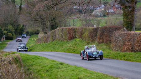 A procession of vintage cars climb Southwaite Hill in Cumbria, England. The cars are taking part in the 11th Flying Scotsman Rally, a free public-event.