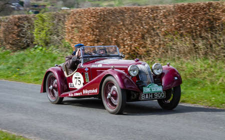 A 1936 Riley TT Sprite climbs Southwaite Hill in Cumbria, England. The car is taking part in the 11th Flying Scotsman Rally, a free public-event.