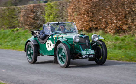 A 1936 Riley 12/4 climbs Southwaite Hill in Cumbria. The car is taking part in the 11th Flying Scotsman Rally, a free public-event.