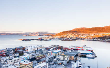The view across the Hammerfest skyline as a Hurtigruten ship is seen docked in the port.  Hammerfest is a town on the island of Kvaloya, Norway. 報道画像